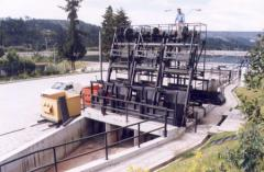 Trash rack cleaning machines for hydroelectric
