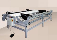 Máquina para rebobinar y medir