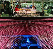 Auxiliares Quimicos para la Industria Textil,